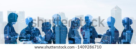 Double exposure of group of businessperson and cityscape. Royalty-Free Stock Photo #1409286710
