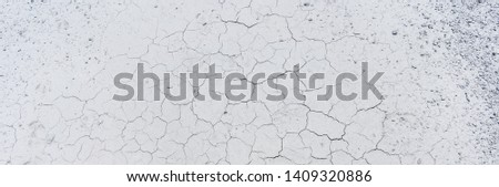 Close up of crack soil and muddy in the dry season textures, hot summer. Patterns and texture cracked soil of sunny dried earth soil, Drought of the ground. Dried cracked earth soil ground background #1409320886