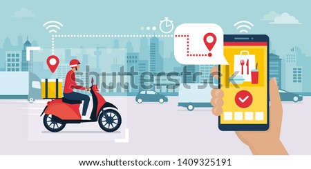 Food delivery app on a smartphone tracking a delivery man on a moped with a ready meal, technology and logistics concept, city skyline in the background #1409325191