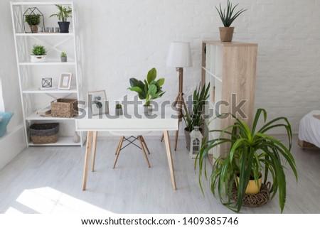 Kiev, Ukraine - April 12, 2019: Room in the Scandinavian white style. Desktop for laptop. #1409385746