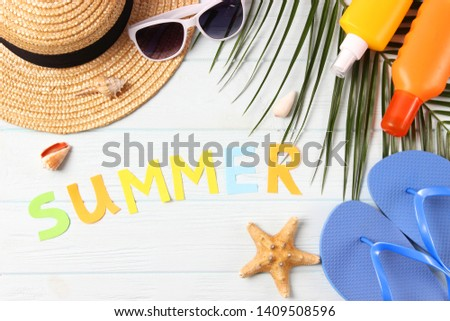"""accessories for the beach and the word """"summer"""" on a colored background top view.  #1409508596"""