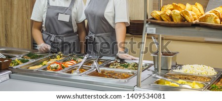 Cuisine cafeteria buffet with food. Self-service food display showcase. Royalty-Free Stock Photo #1409534081