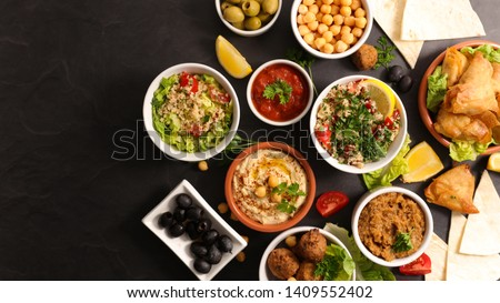 assorted of lebanese food with falafel, hummus,tabouleh,samosa and aubergine caviar #1409552402