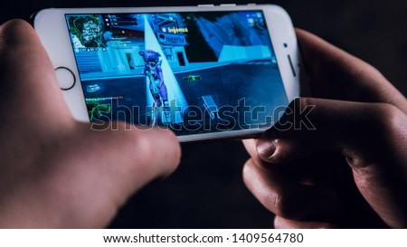 Kocevje/Slovenia -22/5/2019:Close up on popular online game on the telephone .Fortnite on the display of the mobile phone #1409564780