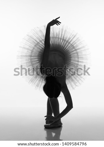 Silhouette of a ballerina. Black and white photo.