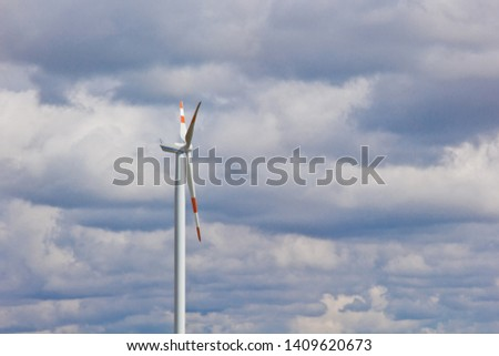 wind power plant on the background of bright cloudy sky. wind generator close-up. green electricity, alternative energy. #1409620673