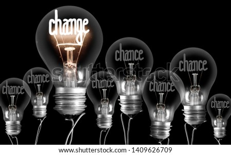 Large group of shining and dimmed light bulbs with fibers in a shape of Chance and Change words isolated on black background; concept of Success and Change #1409626709