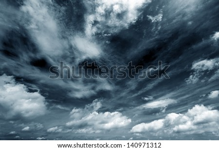 Background of dark clouds before a thunder-storm Royalty-Free Stock Photo #140971312