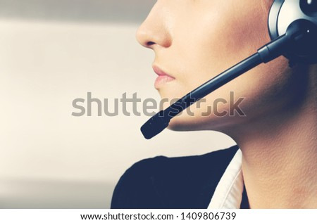 Woman Call Center operator on dark background #1409806739