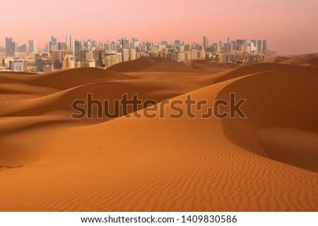 Dunes of Desert at dawn and skyscrapers of  Dubai (United Arab Emirates) #1409830586