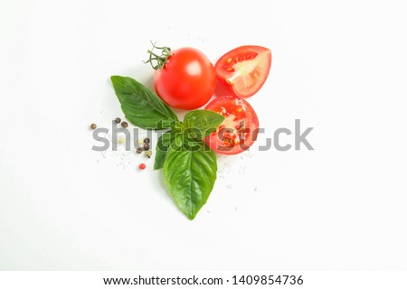 Fresh cherry tomatoes with basil and spices on white background, space for text and top view. Ripe vegetables #1409854736