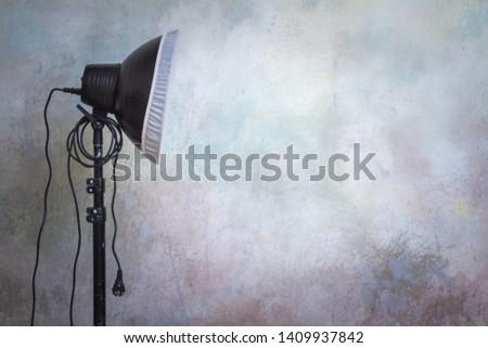 Professional lighting equipment in the photo studio on the original gray background, minimalist interior and lighting equipment #1409937842