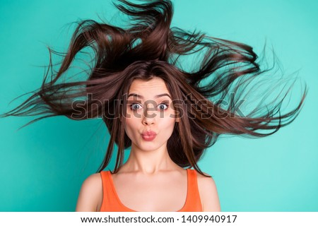 Close up photo amazing beautiful her she lady send air kisses friends weekend vacation wind blowing hair flight healthy condition wear casual orange tank-top isolated bright teal turquoise background #1409940917