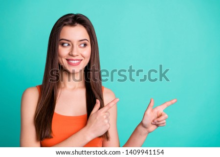 Close up photo charming lady youth people positive cheerful satisfied advertise choose decide advertisement indicate present display attention advise long modern cute outfit isolated teal background #1409941154