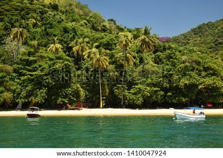 Beautiful tropical beach on the Ilha Grande. Ilha Grande is an island located off the coast of Rio de Janeiro state, Brazil.   #1410047924