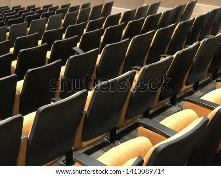 convention hall with yellow chairs #1410089714