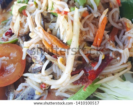 Thai food style, Papaya salad with tomato, shrimp, chili, bean, morning glory and cabbage as a background, This food is most popular Thai food, Som Tum is thai traditional, Selective focus #1410100517
