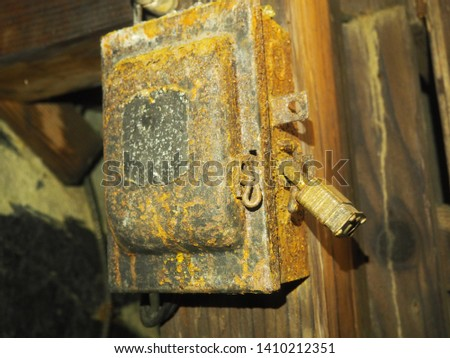 A rusty box with a rusty lock attached to it. #1410212351