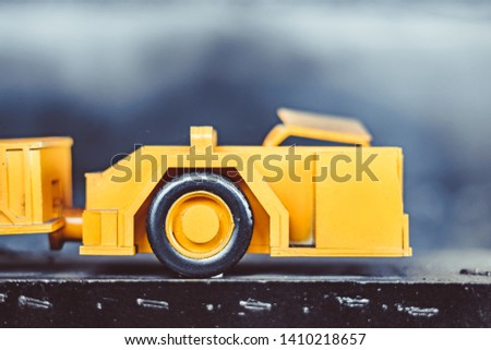 toy tractor in the scenery of coal mining #1410218657