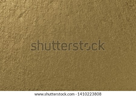 Light bronze background of natural slate. Texture of golden stone closeup. Graphite backdrop macro #1410223808