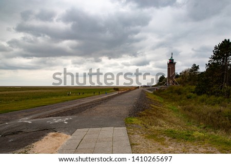 St. Peter Ording dike with lighthouse #1410265697