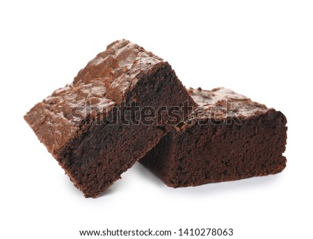 Pieces of fresh brownie on white background. Delicious chocolate pie #1410278063