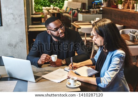 You'll be happier at work when you make some friends there. Two colleagues having lunch in company's restaurant. Cozy interior Royalty-Free Stock Photo #1410287120