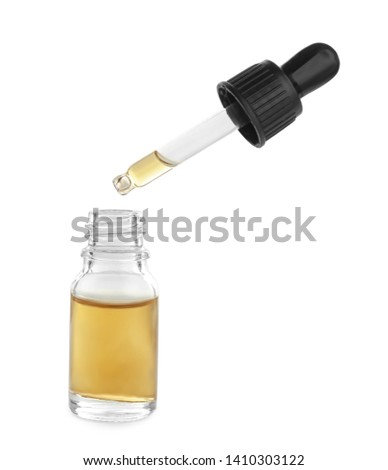 Little bottle with essential oil and dropper on white background #1410303122