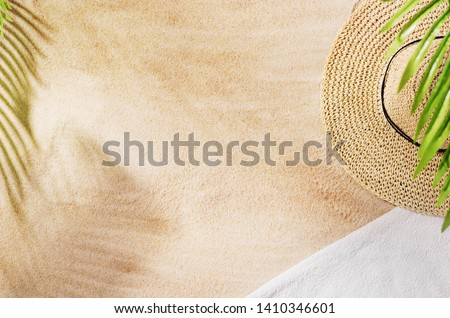 Sandy beach background top view with visible sand texture. Backdrop for mockups and advertising. #1410346601