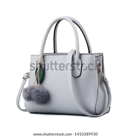Women's Gray Leather Bag Isolated on White Background. Side View of Luxury Genuine Full Grain Leather Lady Shopping Bag. Women Top Handle Shopper Tote Bag Padlock. Handbags & Fashion Accessories #1410389930