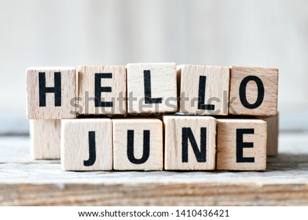 Hello June. Wooden letters spelling Hello June on wooden background #1410436421