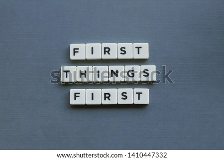 ' First Things First ' word made of square letter word on grey background. #1410447332