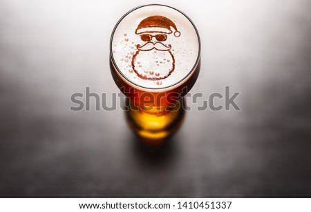 Christmas or New Year beer concept. Star symbol on beer glass foam on black table, view from above