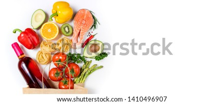 Healthy food background. Healthy food in paper bag fish, pasta, vegetables, fruits and wine on white background. Shopping food supermarket concept. Healthy eating, cooking dinner concept #1410496907