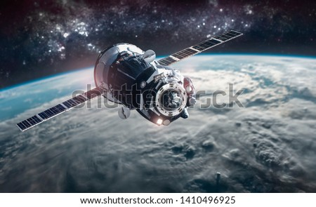 Planet Earth and space craft view. Stars and planet unfocused. Elements of this image furnished by NASA Royalty-Free Stock Photo #1410496925