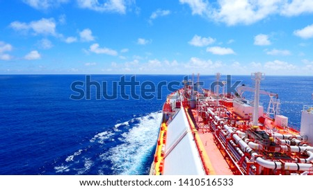 LNG vessel crossing atlantic ocean during good weather Royalty-Free Stock Photo #1410516533