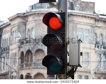 Red signal traffic lights in a European city #1410571604