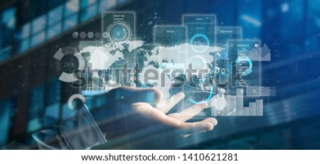 View of Businessman holding User interface screens with icon, stats and data 3d rendering #1410621281