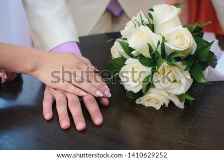 hands of the bride and groom with gold rings at the wedding ceremony #1410629252