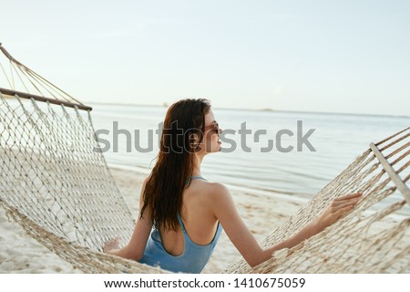 Pretty woman resting in a hammock beach trip vacation nature vacation vacation relaxation Summer sun #1410675059