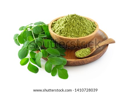 Moringa powder (Moringa Oleifera) in wooden bowl with original fresh Moringa leaves isolated on white background. Healthy product, superfood, vitamin. #1410728039