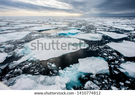 Dramatic wide angle view of melting  arctic sea ice floes breaking up taken at sea.Climate Crisis and Breakdown.Climate Emergency- Image #1410774812