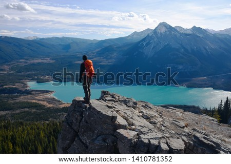 People enjoying the mountain views of the great outdoors, hiking and exploring the trails and valleys of the Canadian Rockies. #1410781352