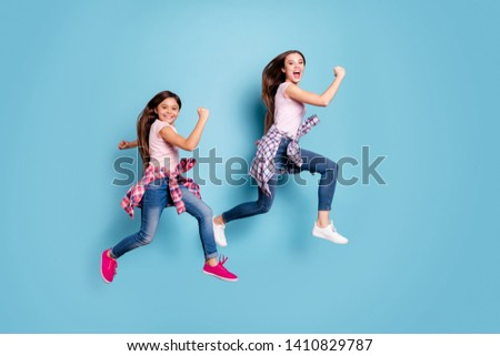 Full length body size profile side view portrait of two nice attractive cheerful straight-haired girls hipster outfit fast season sale discount isolated on bright vivid shine blue turquoise background #1410829787