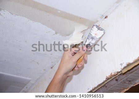 Ceiling repair. Old ceiling. Removal of a layer of putty. #1410956513