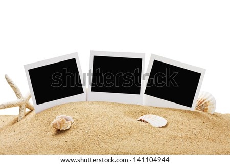 photo frame on the sea sand isolated on white background