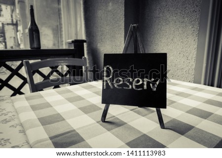 Reserved table in cafe background #1411113983