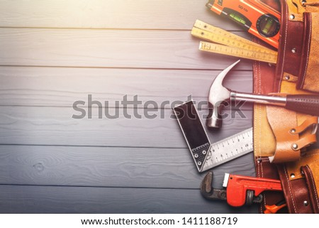 Tool belt with tools on wooden background #1411188719