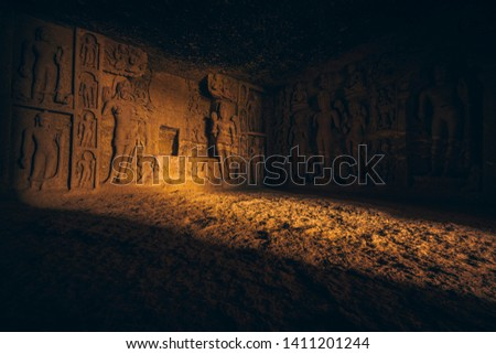 Stone carved Hindu temple with beautiful sunlight and sculptures. Cave, cavern in Mumbai, India #1411201244