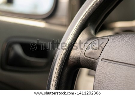 driving wheel with horn sign, car interior Royalty-Free Stock Photo #1411202306